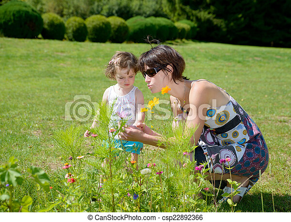 a beautiful mom is a hug to her daughter - csp22892366