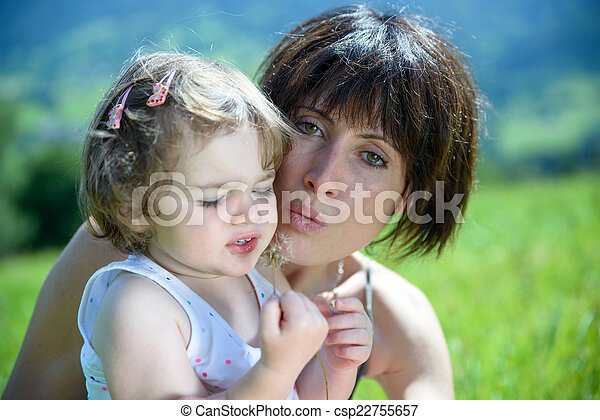 a beautiful mom is a hug to her daughter - csp22755657