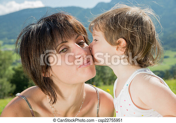 a beautiful mom is a hug to her daughter in nature - csp22755951