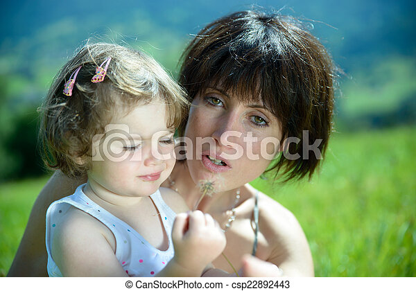 a beautiful mom is a hug to her daughter - csp22892443