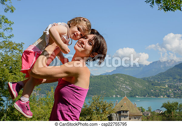 a beautiful mom is a hug to her daughter in nature - csp22755795