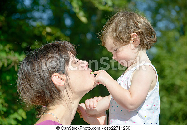 a beautiful mother and daughter playing together - csp22711250