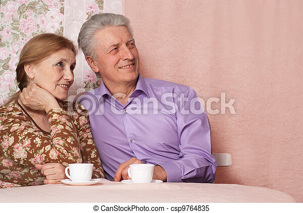A beautiful pair of pensioner people sitting together - csp9764835