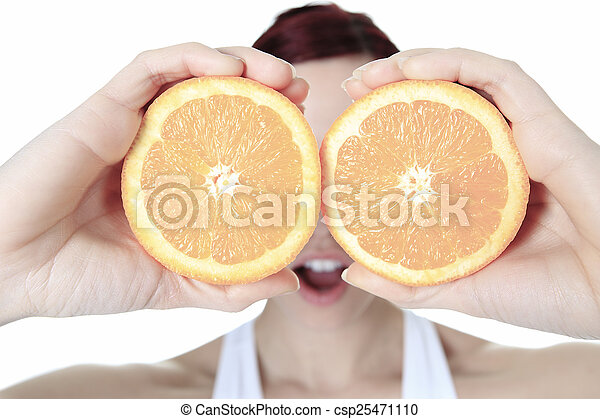 A beautiful training woman with fruit background - csp25471110