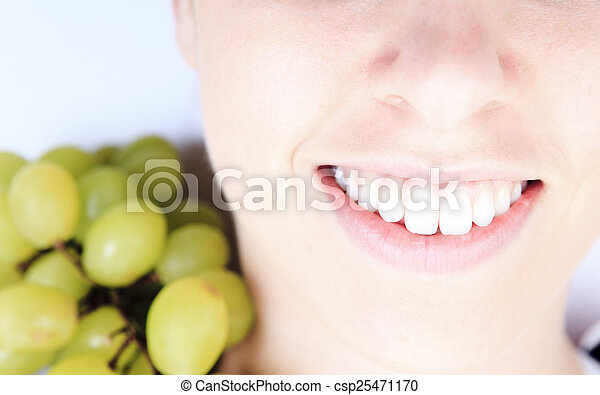 A beautiful training woman with fruit background - csp25471170