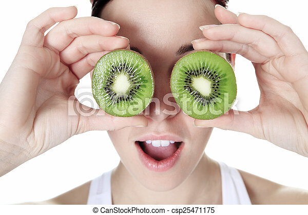 A beautiful training woman with fruit background - csp25471175