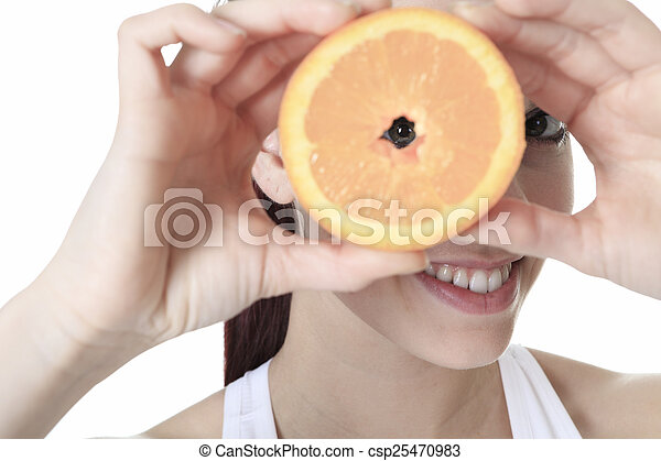 A beautiful training woman with fruit background - csp25470983