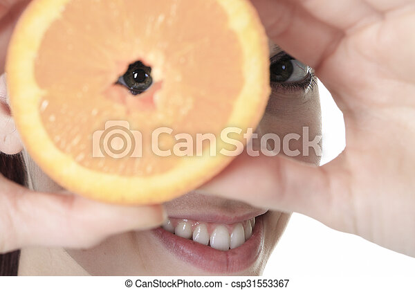 A beautiful training woman with fruit background - csp31553367