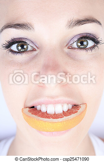 A beautiful training woman with fruit background - csp25471090