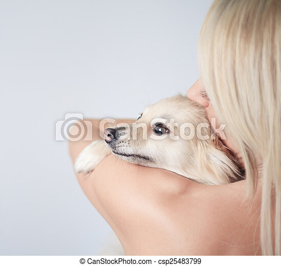 A Beautiful woman fashion, holding dog in studio gray background - csp25483799