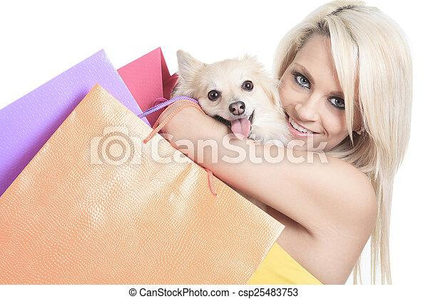 A Beautiful woman friends fashion, holding dog in studio gray ba - csp25483753