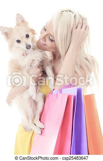 A Beautiful woman friends fashion, holding dog in studio gray ba - csp25483647