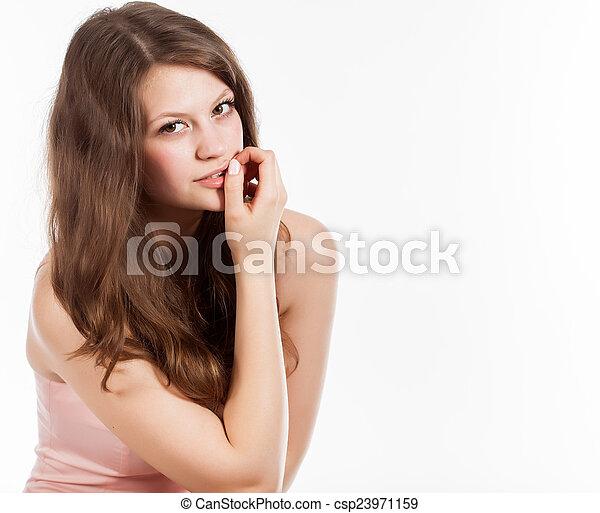 A beautiful woman in studio - csp23971159