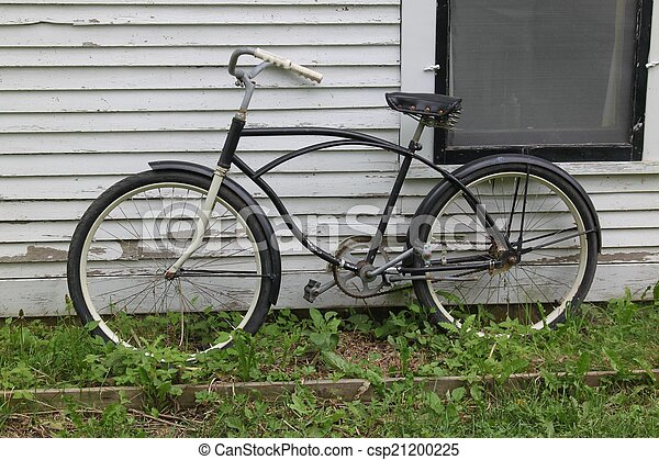 A bicycle leaning against a wall - csp21200225