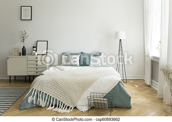 A Big Comfortable Bed With Pale Sage Green And White Linen
