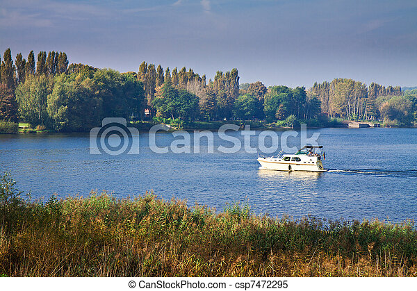 A boat on the river Havel in Germany. - csp7472295