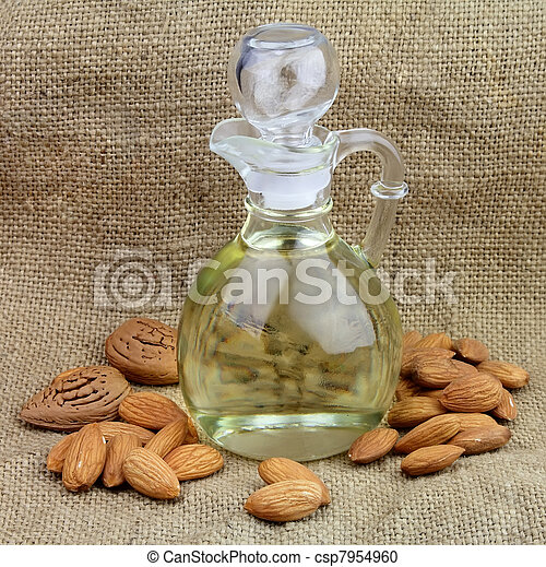 A bottle of almond oil with nuts - csp7954960