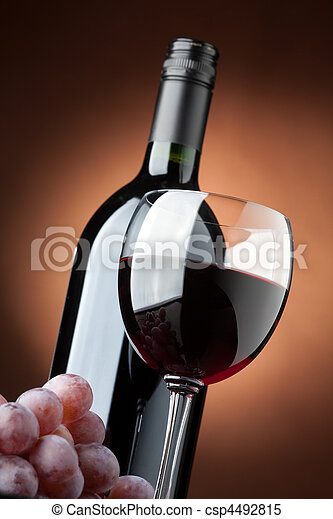 A bottle of red wine and a wine glass closeup - csp4492815