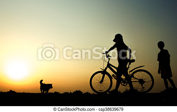 A boy and Woman fitness silhouette sunrise cycling workout wellness concept. - csp38639679