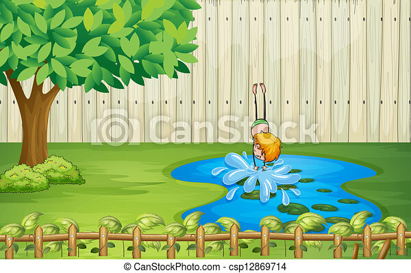 A boy diving in the pond - csp12869714