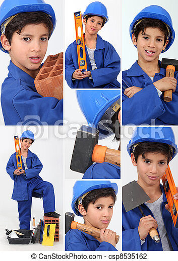 a boy dressed in workman with tools - csp8535162