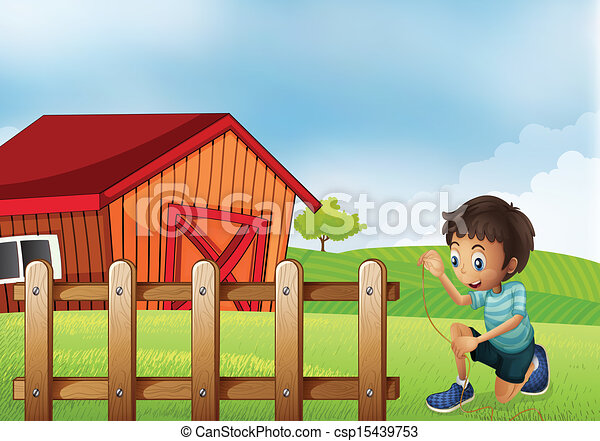 A boy holding a rope at the farm - csp15439753