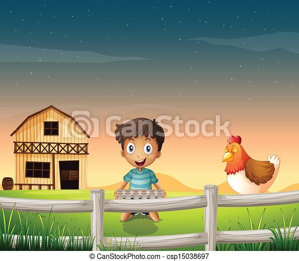 A boy holding an egg tray near the sleeping chicken - csp15038697