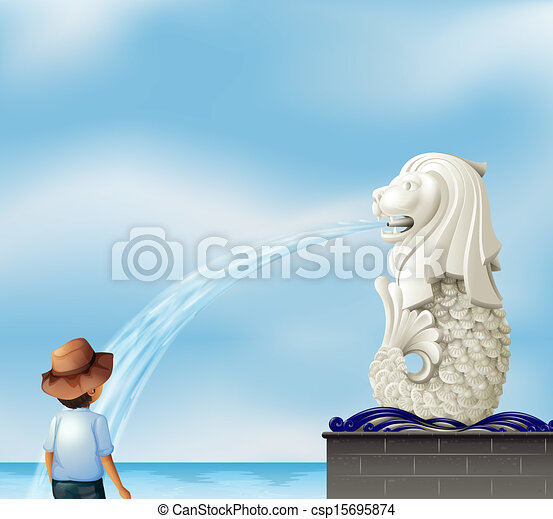 A boy in front of the Merlion statue - csp15695874