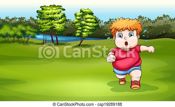 A boy jogging near the river - csp19289188