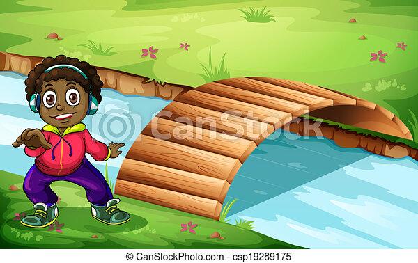 A boy near the bridge - csp19289175