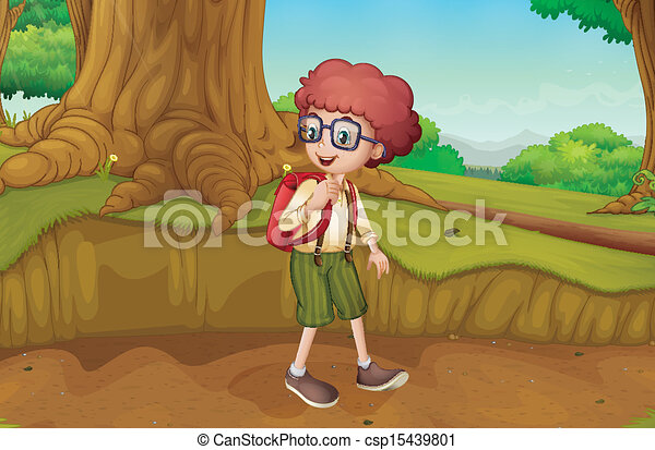 A boy near the roots of a giant tree - csp15439801