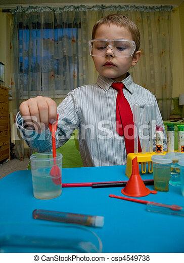 A boy plays in the scientist chemist - csp4549738
