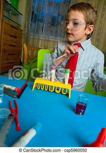 A boy plays in the scientist chemist - csp5960050