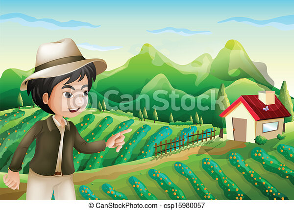 A boy pointing at the barnhouse at the farm - csp15980057