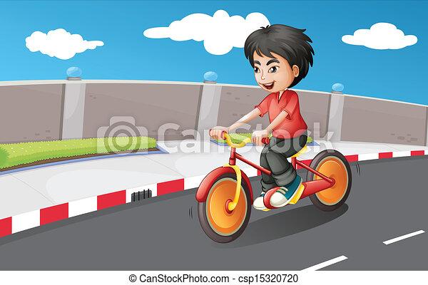 A boy riding in his bike with orange wheels - csp15320720