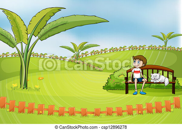 A boy sitting in the park with his pet - csp12896278