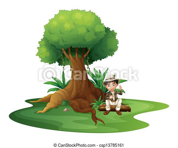 A boy sitting under the big tree - csp13785161