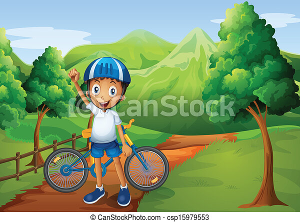 A boy standing in the pathway with his bike - csp15979553