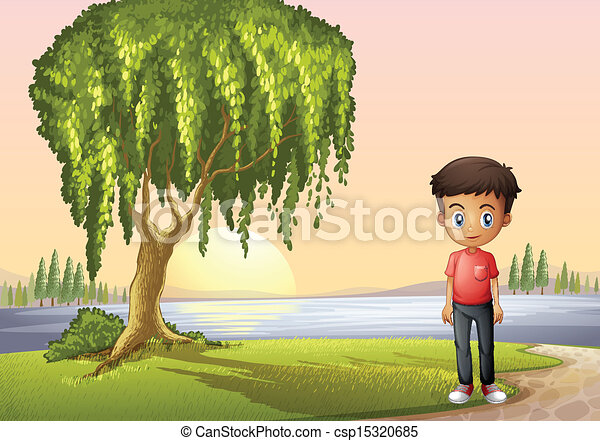 A boy standing near the giant tree - csp15320685