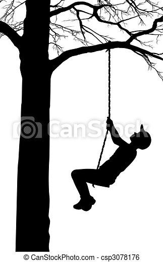 A boy swings on a tree - csp3078176