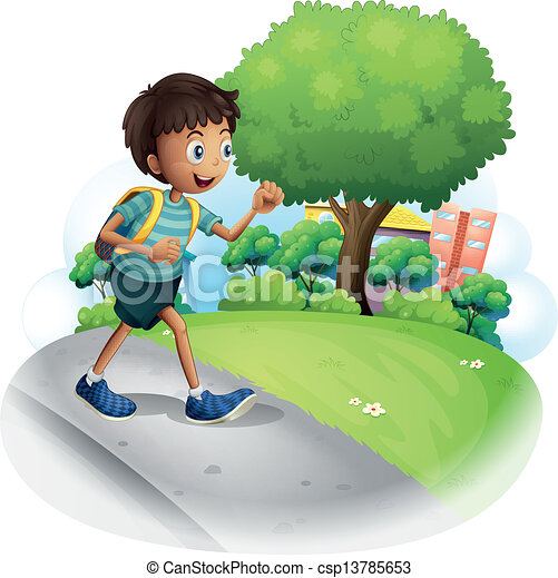 A boy with a bag walking along the street - csp13785653