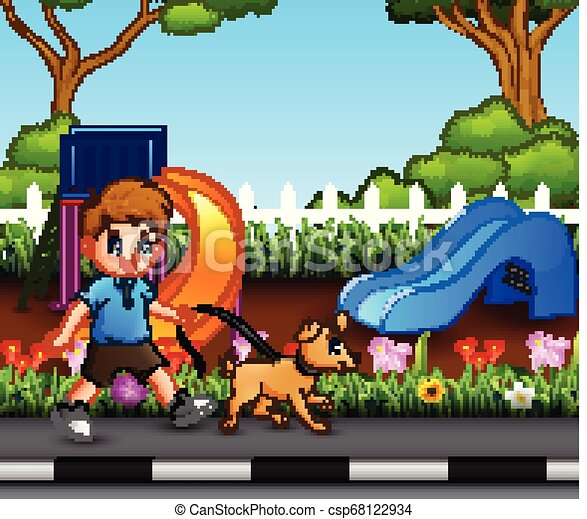 A boy with his pet walking in the city park - csp68122934