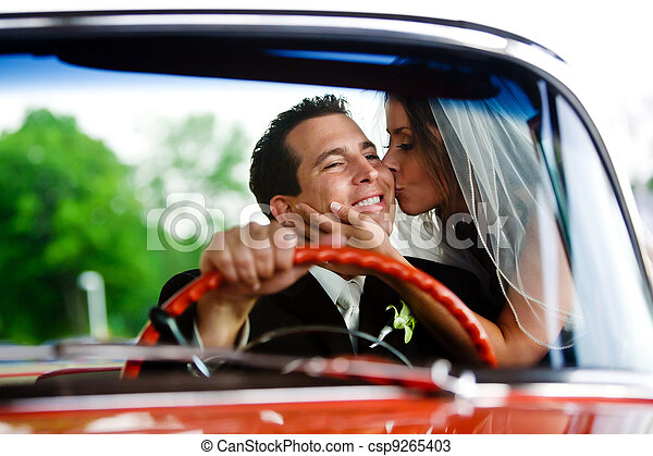 A bride kissing her groom - csp9265403