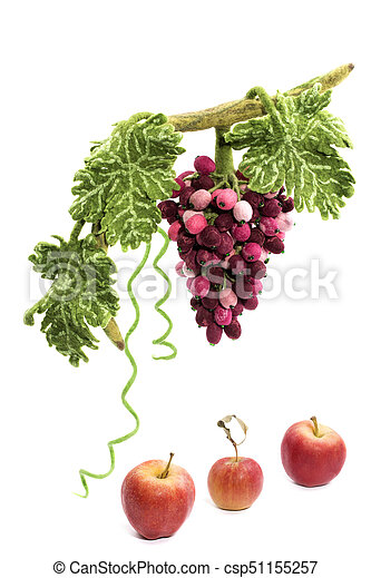 A bunch of grapes from felted wool next to apples on a white background - csp51155257