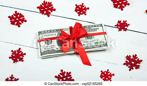 A bundle of money tied with a red ribbon - csp52165265