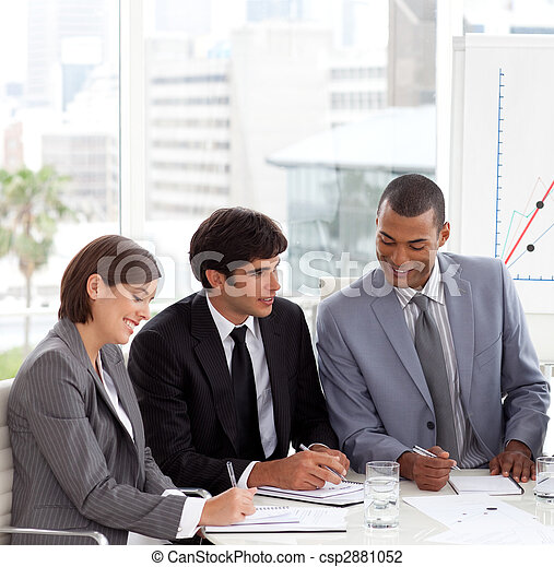 A Business group showing diversity discussing a new strategy  - csp2881052