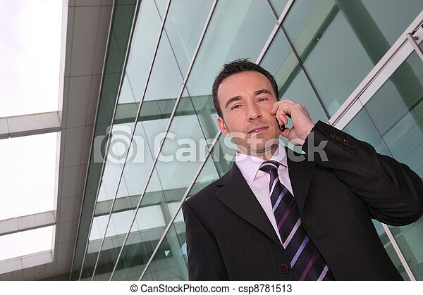 a business man at phone - csp8781513