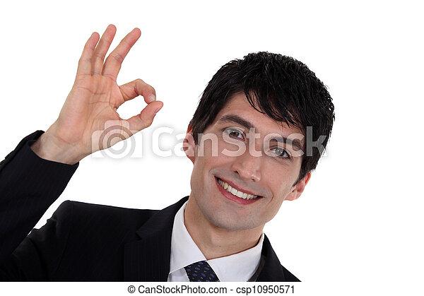 A businessman gesturing an ok sign. - csp10950571