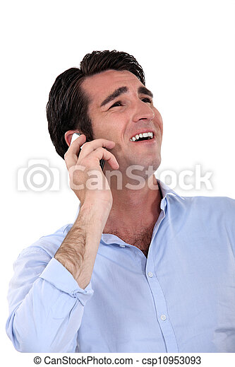 A businessman laughing over the phone. - csp10953093