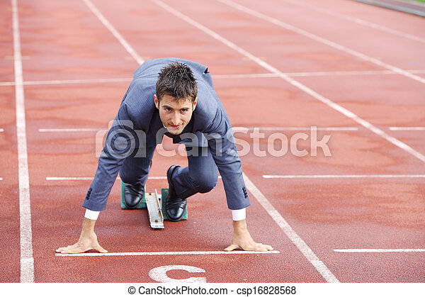 A businessman on a track ready to run  - csp16828568